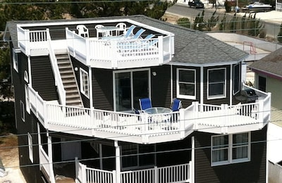 3 levels of outdoor entertaining - including BBQ grill + private roof-top deck.