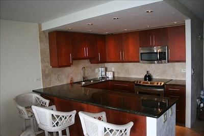 New Cherry cabinets, stainless appliances and granite countertops