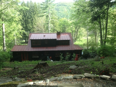 the upper seating area facing rear of house and view, with two lounges