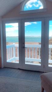 A view of the inside looking at the ocean during the fall season.