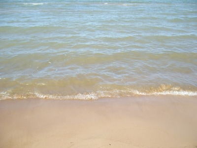 You are directly on this sand beach!!  No stones,