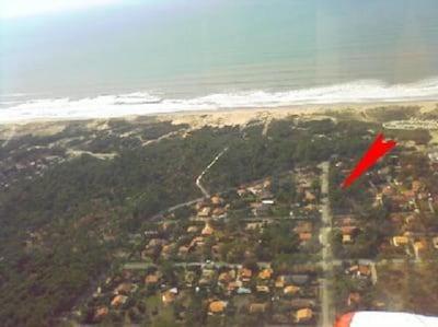Vue aérienne La maison ce situe au bout de la flèche rouge.
