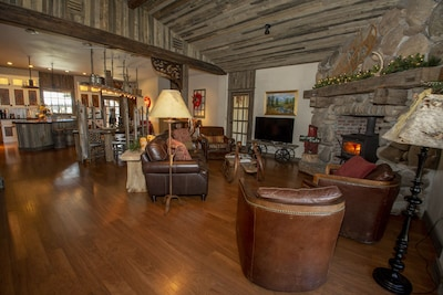 Cozy living room with wood burning stove and custom river rock wall