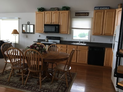 Open concept kitchen with dishwasher and garbage disposal