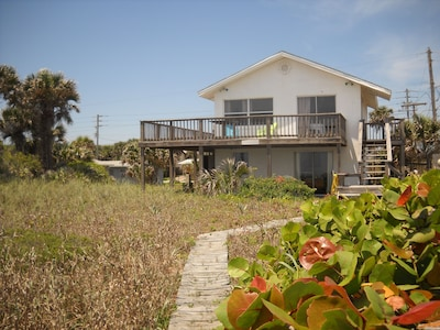 This downstairs unit is part of a duplex, and  only a few steps to the beach!