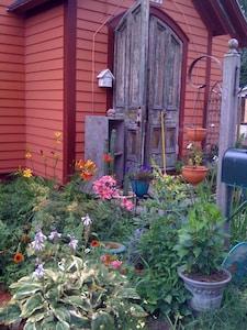 Flowers aplenty in summer by the front door.