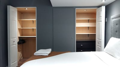 large built-in oak closets with full sized dresser