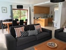 Open plan, stylish and spacious living room, dining area and kitchen.