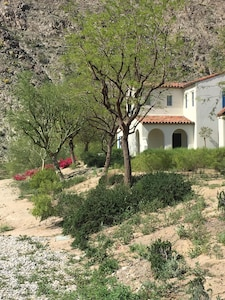 Surrounded by beautiful natural desert landscape with easy access to loop trail.
