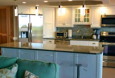 Large, bright kitchen with counter seating
