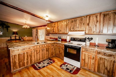 Full kitchen with stove/oven, refrigerator, coffeemaker and 2 dining areas.