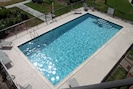 Large Clean Pool Right Outside Your Door. Plenty of seating.