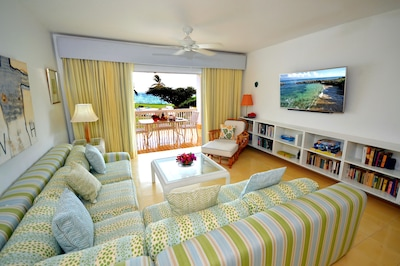 Relax on our large couch and look at the sea, or watch our 55 inch HDTV