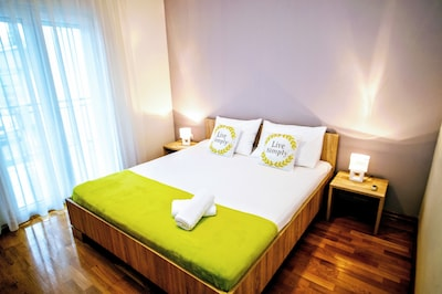 bedroom with large double bed and balcony access