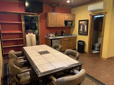 Full kitchen/dining area in between both bedrooms.