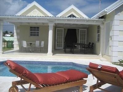 The pool area & back patio at Hummingbird House