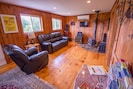 Living room has TV, DVD player, gas fireplace and leather reclining furniture.