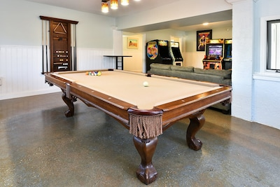 Pool table with ping pong top, 4 full size video games and a bar top game system