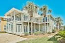 View of front of house with numerous bedrooms/decks with views of Gulf of Mexico