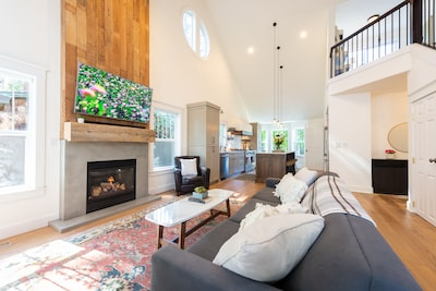 Completely remodeled living area and kitchen with soaring ceilings.