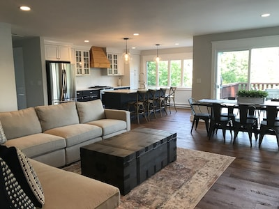 Main level: open living room, dining and kitchen