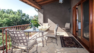 Looking across your private terrace. Large table, comfy chairs, overhead heater.