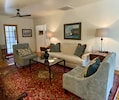 Living room with original artwork and a gorgeous collection of oriental rugs