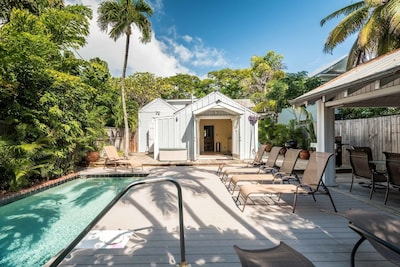 Backyard with pool and covered Lanai for outdoor dining