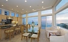 Open floor plan in the kitchen & dining areas with sights & sounds of the ocean.