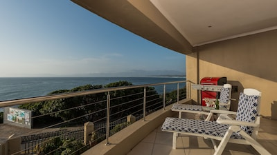 Time for a sundowner on the large balcony  (and to watch the whales & dolphins)