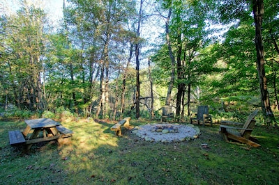 Fire pit and picnic area of the 1848 log cabin.