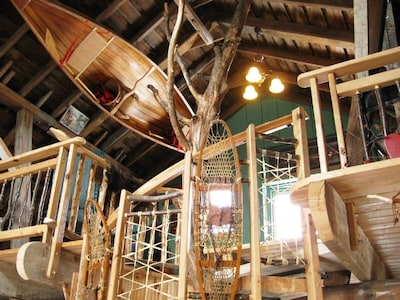 a magical loft hide-away with a tree spiral staircase