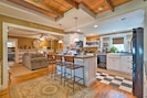 The living space flows into the charming fully equipped kitchen.