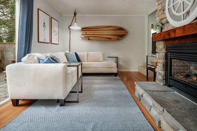 Relax by the fireplace and enjoy your time at The Saltwater Cottage