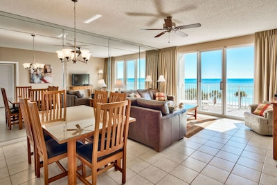 Dining area and living area with full views of the Gulf