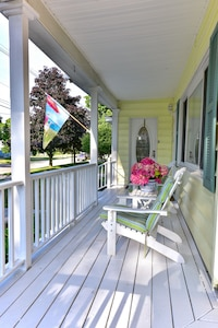 Large wrap around porch with seating and hammock