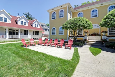 The front patio has a sun soaked western exposure with eight Adirondack chairs.