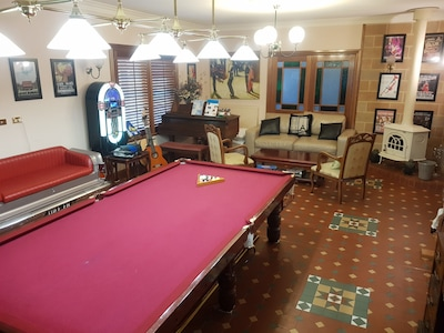 Games room, with jukebox, pool table, EH Holden lounge, fire, pull out lounge.