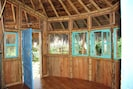 handmade cabins from Bamboo & local woods. Each Cabin is fully screened.