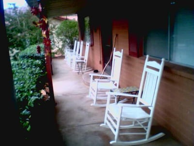 Master House front porch with rocking chairs