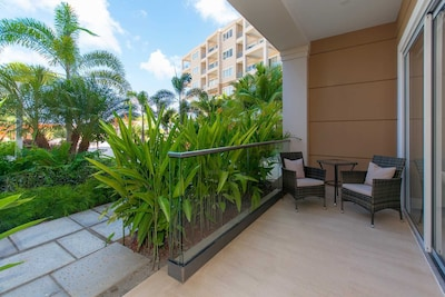 Your veranda with seating to enjoy the Aruban weather at the Pearl Garden Two-bedroom condo