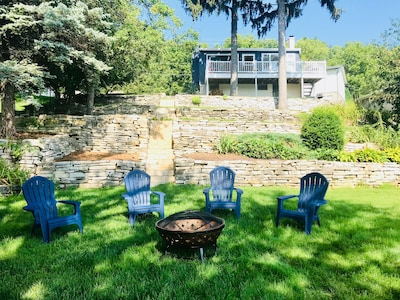 fire pit by the water with seating for 4