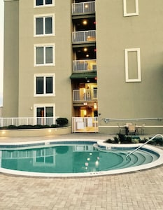 Your private gated patio overlooking the pool deck!