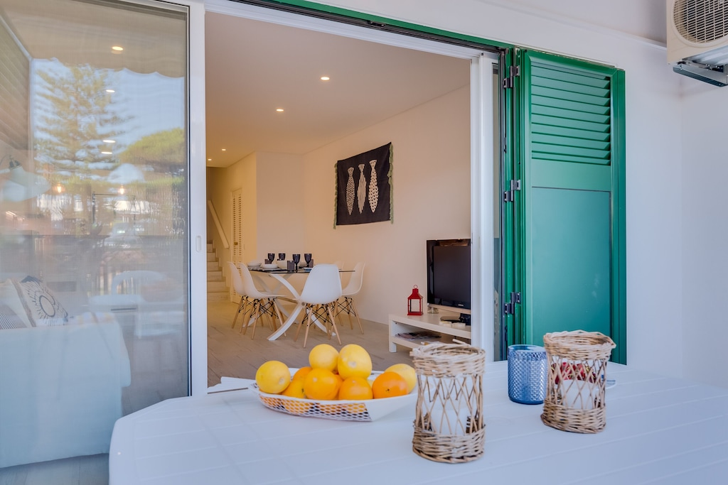 Terrace and living room views of a vacation rental just steps away from the sandy beaches of Vale do Lobo