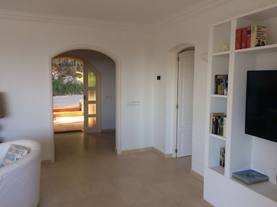 Looking out from sitting room towards entrance.