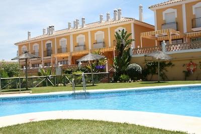 Precioso adosado en Islantilla con terraza de  20m