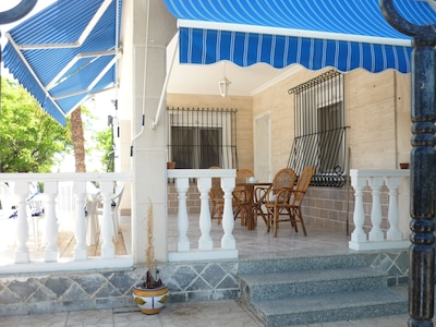 PATIO WITH SUNBLINDS