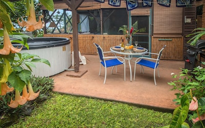 Tropical Hideaway, showing patio entrance with hot tub, outdoor dining, gas BBQ