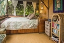 Queen bed with ocean and garden views