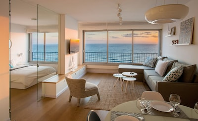 Breathtaking ocean views. A curtain on the glass wall can be closed for privacy.